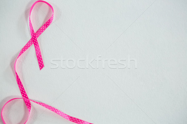 Overhead view of pink spotted Breast Cancer Awareness ribbon Stock photo © wavebreak_media