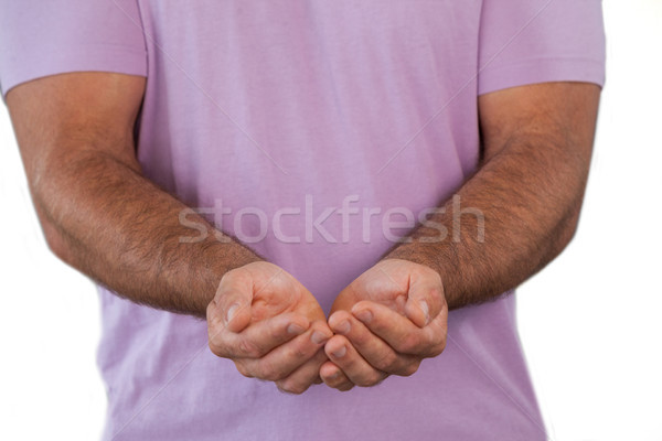 Mid section of man with hands cupped Stock photo © wavebreak_media