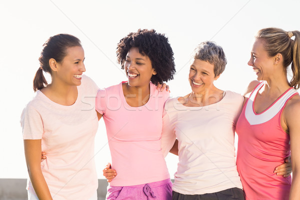 Laughing women wearing pink for breast cancer Stock photo © wavebreak_media