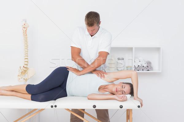 Doctor examining his patient pelvis Stock photo © wavebreak_media