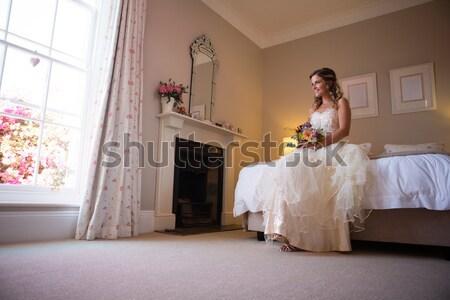 Ritratto felice sposa damigella d'onore champagne piedi Foto d'archivio © wavebreak_media