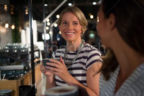 Happy woman interacting while having coffee Stock photo © wavebreak_media