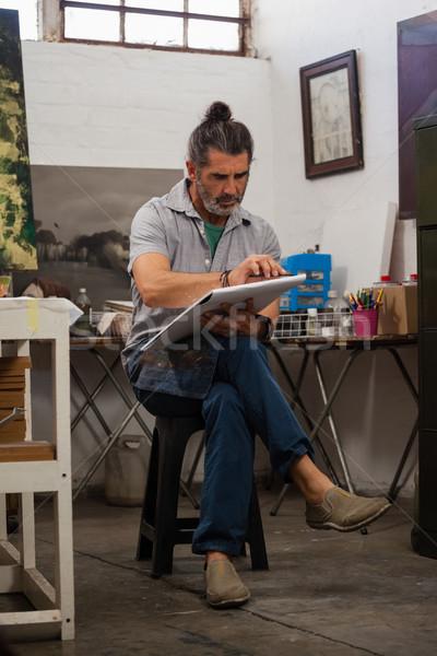 Man painting in drawing book Stock photo © wavebreak_media