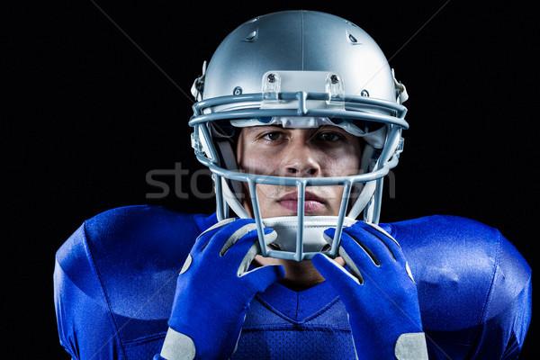 Portrait of serious sportsman holding helmet Stock photo © wavebreak_media