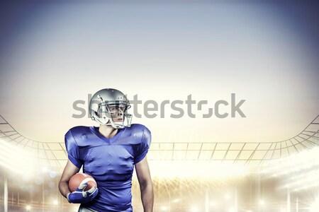 Aggressive American football player in red jersey screaming Stock photo © wavebreak_media