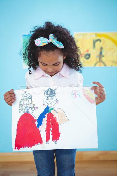 Cute girl showing her drawing Stock photo © wavebreak_media