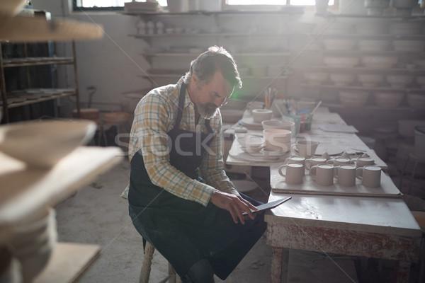 Male potter using digital tablet at worktop Stock photo © wavebreak_media