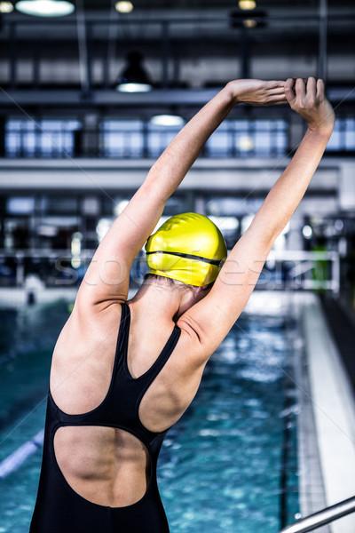 Nuotatore donna bordo piscina vista posteriore Foto d'archivio © wavebreak_media