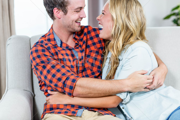 Couple hugging on the couch Stock photo © wavebreak_media