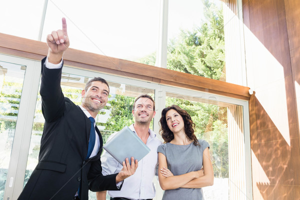 Real-estate agent showing couple new home Stock photo © wavebreak_media