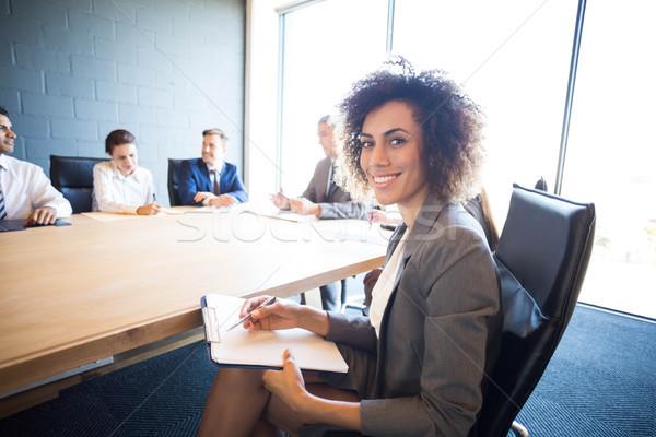 Pessoas de negócios discutir conferência reunião tabela escritório Foto stock © wavebreak_media