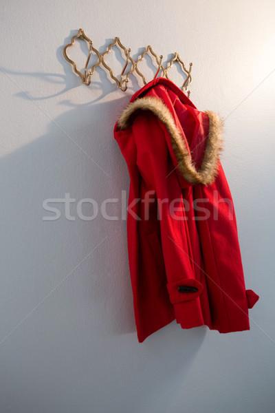 Red hoodie hanging on hook Stock photo © wavebreak_media