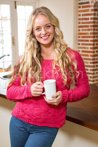 Pretty woman holding her mug of coffee Stock photo © wavebreak_media