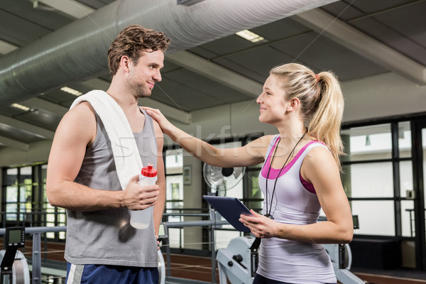 Man interacting with his trainer after a workout Stock photo © wavebreak_media