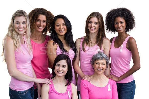 Sorridente mulheres rosa posando câncer de mama consciência Foto stock © wavebreak_media