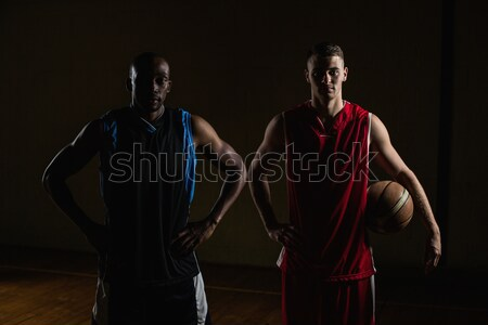 Portrait of basketball players posing with hands on hips  Stock photo © wavebreak_media