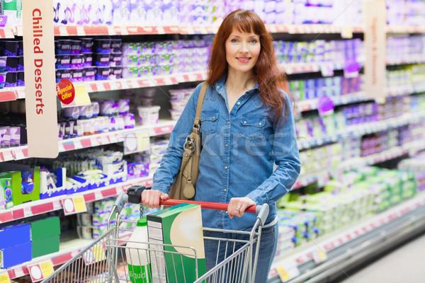 Sorridere cliente caseificio sezione supermercato business Foto d'archivio © wavebreak_media