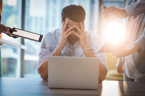 Hayal kırıklığına uğramış işadamı oturma büro el kafa Stok fotoğraf © wavebreak_media