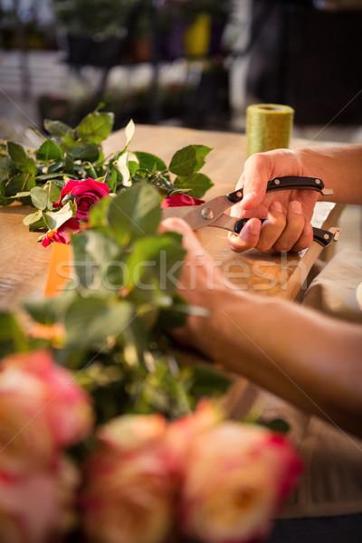 Maschio fiorista fiori rosa Foto d'archivio © wavebreak_media
