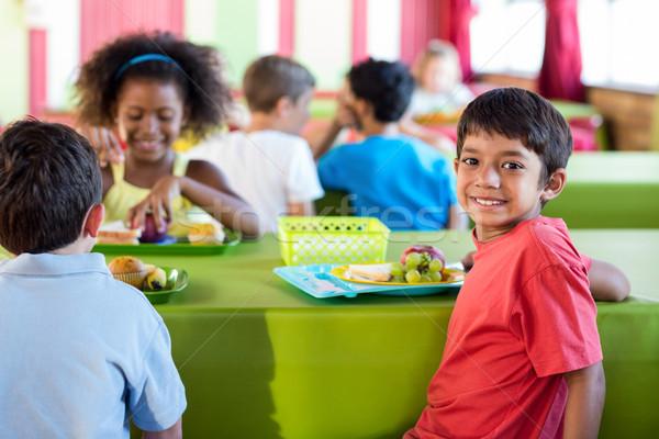 мальчика Одноклассники еды портрет Cute столовая Сток-фото © wavebreak_media