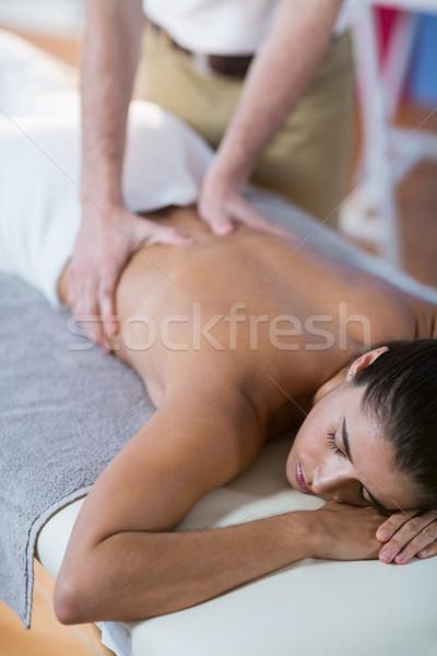Masculina atrás masaje femenino paciente clínica Foto stock © wavebreak_media