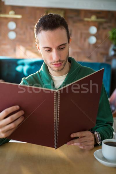 Man looking at menu Stock photo © wavebreak_media