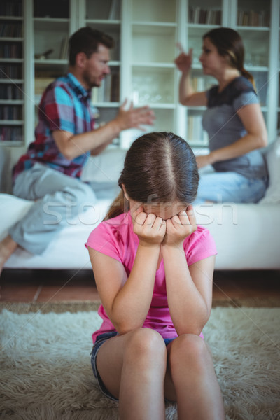 Sad girl crying while parents arguing in living room Stock photo © wavebreak_media