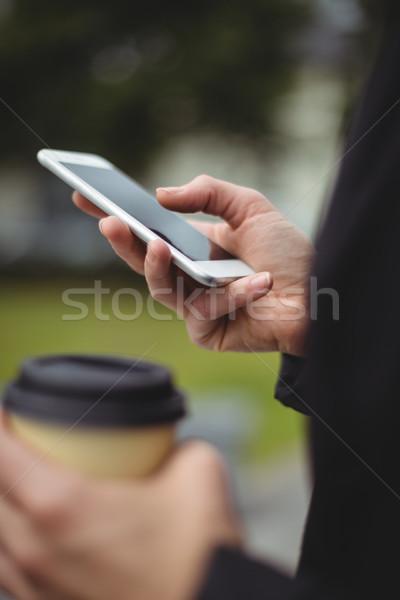 女性実業家 携帯電話 使い捨て コーヒーカップ ストックフォト © wavebreak_media