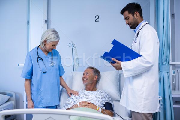 Doctor and nurse examining a patient Stock photo © wavebreak_media
