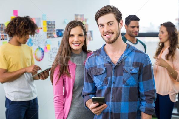 Retrato feliz gráfico teléfono móvil colegas negocios Foto stock © wavebreak_media