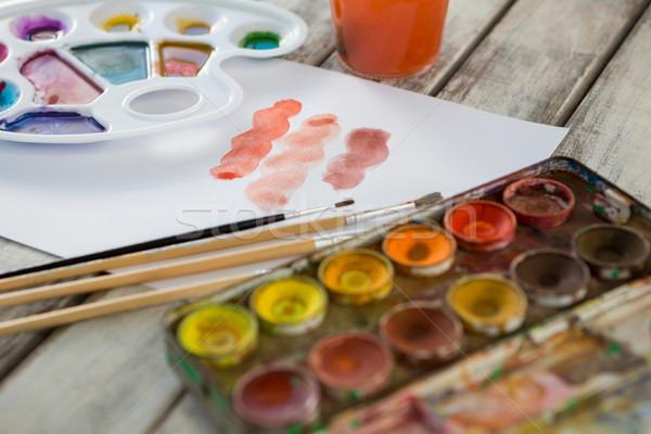 Farbenreich Palette Pinsel Papier Holz Oberfläche Stock foto © wavebreak_media