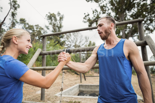 Fit man and woman greetings during obstacle course Stock photo © wavebreak_media