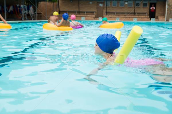 Girl swimming in the pool Stock photo © wavebreak_media