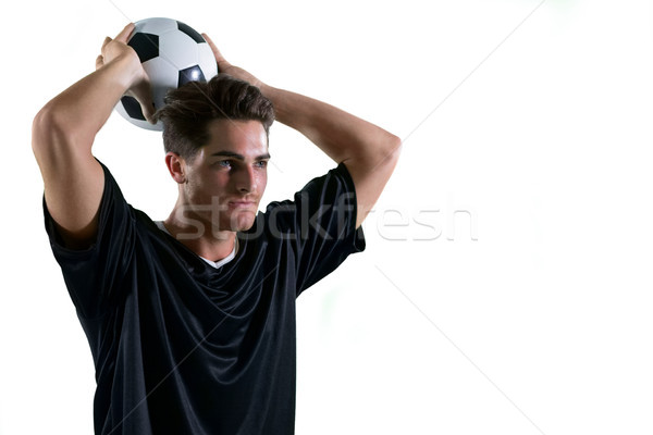 Football player about to throw the football Stock photo © wavebreak_media