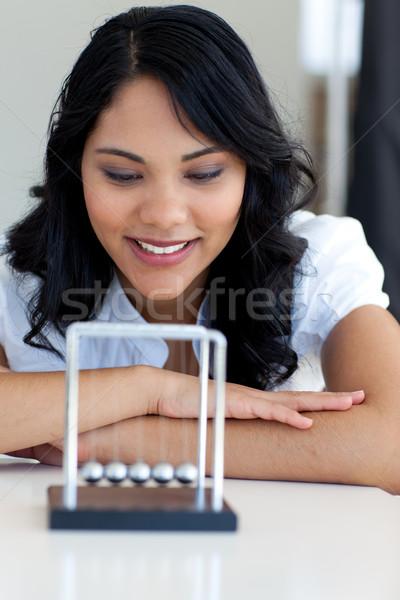 Businesswoman looking at kinetic balls Stock photo © wavebreak_media