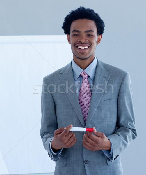 Afro empresario presentación equipo negocios mano Foto stock © wavebreak_media
