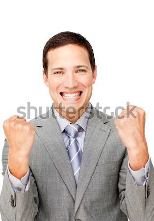 Charismatic businessman punching the air in celebration  Stock photo © wavebreak_media