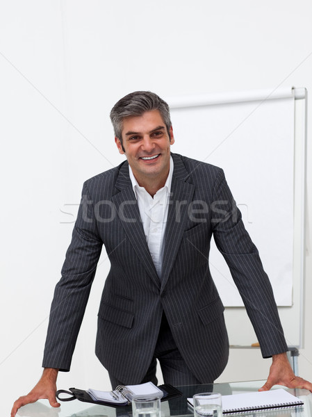 Assertive businessman leaning on a conference table  Stock photo © wavebreak_media