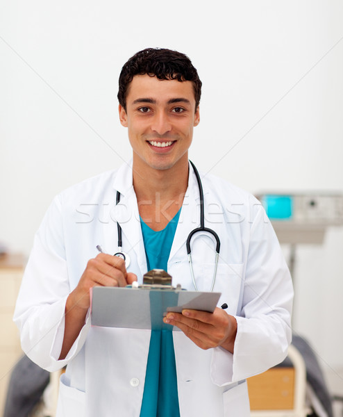 Young male Doctor holding a clip board Stock photo © wavebreak_media