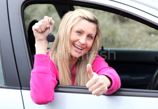 Happy female driver showing a key after bying a new car  Stock photo © wavebreak_media