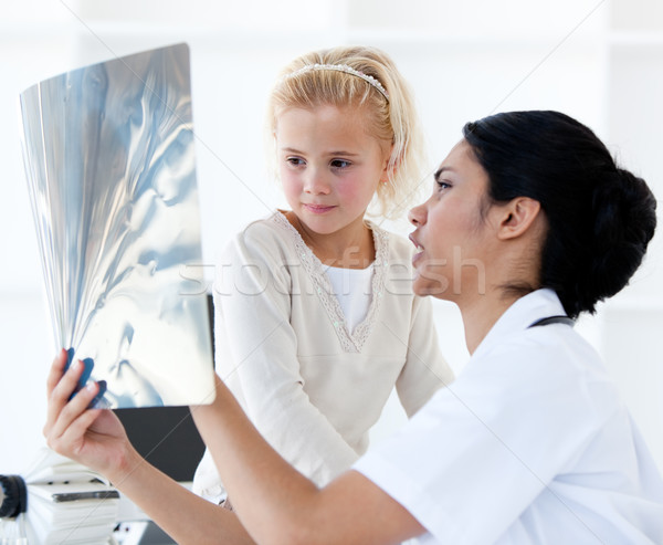 Confident female doctor showing an x-ray to a little girl Stock photo © wavebreak_media