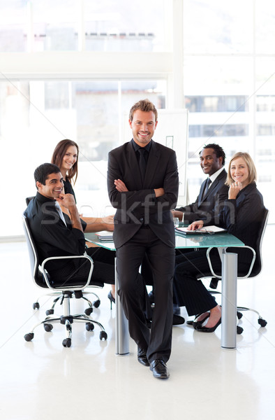 Stock photo: Confident businessman with folded arms in a presentation