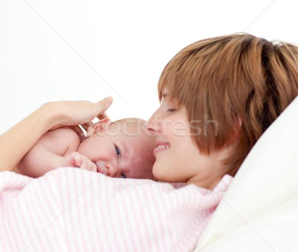 Beautiful patient with newborn baby in bed Stock photo © wavebreak_media