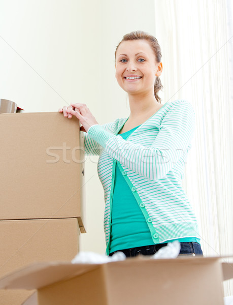 Attractive woman writing on boxes using a pen  Stock photo © wavebreak_media