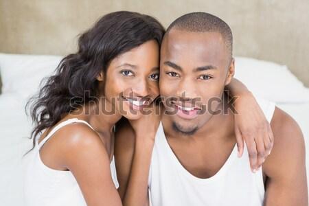 молодые улыбаясь романтические пару расслабляющая кровать Сток-фото © wavebreak_media