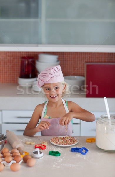 Sweet young girl working in the kitchen baking cookies Stock photo © wavebreak_media