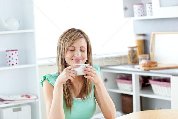 довольно наслаждаться кофе сидят кухне Сток-фото © wavebreak_media