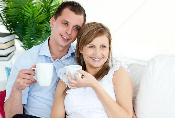 внимательный питьевой кофе сидят диван Сток-фото © wavebreak_media