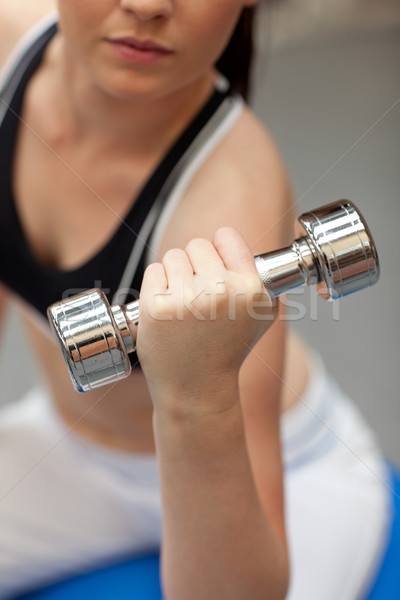Portrait of a cute woman working out with dumbbells in a fitness center Stock photo © wavebreak_media