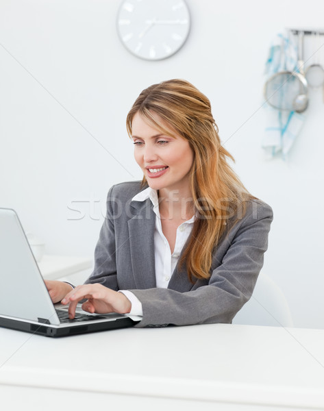 Businesswoman looking at her laptop at home Stock photo © wavebreak_media